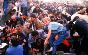 Mandatory Credit: Photo by Isopix/REX_Shutterstock (518623b)  FOOTBALL FANS GETTING CRUSHED IN STAMPEDE DURING FIGHTING BETWEEN LIVERPOOL AND JUVENTUS TURIN FANS DURING THE EUROPEAN CUP FINAL  HEYSEL STADIUM DISASTER, EUROPEAN CUP FINAL, BRUSSELS, BELGIUM - 1985